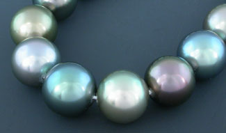 Flawless and perfetly matched rounds, this 9mm strand exhebits blue, green and rose overtones.  Inventory #10606
