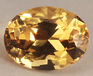 10987 A 1.74 Carat ovall brilliant heliodore from the Roebling/Merryall MIne, Litchchfield, Ct.  The gem exhibets an exceptional vivid medium toned golden hue.