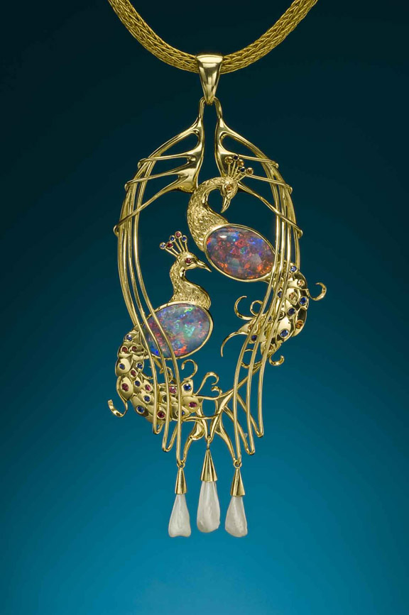 22k/18k hand fabricated Peacock Pendant. The piece is accented with two black opals from the Moonshine Field at Lightning Ridge as well as rubies, sapphires, natural Mississippi pearls and spessartite garnets. Designed and handmade by R. W. Wise, Goldsmiths, Michael Corneau, designer/craftsman.